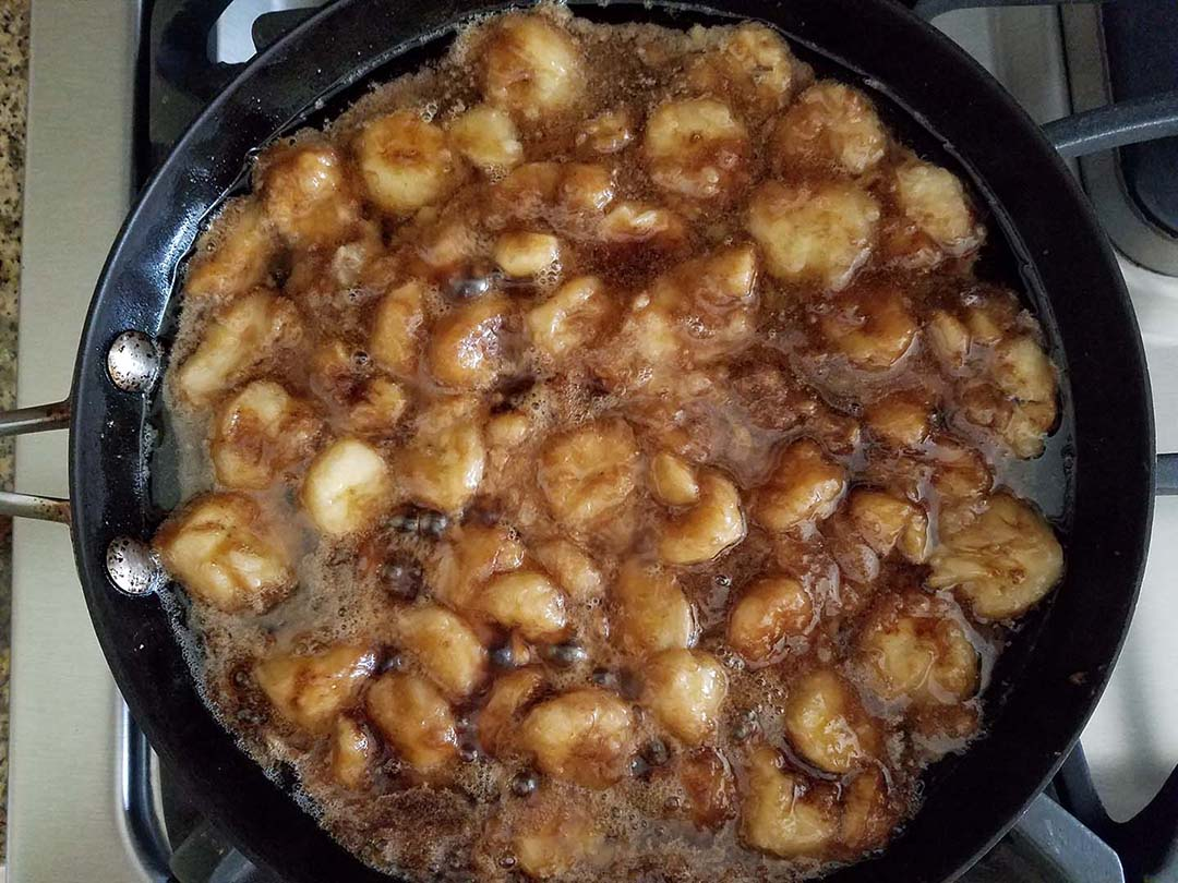 caramelizing bananas, brown sugar, and coconut oil in skillet