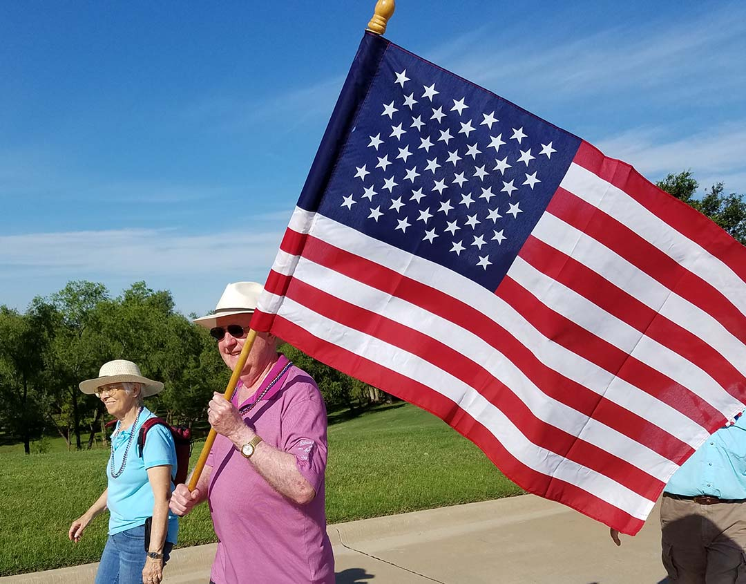 Happy 4th of July - carrying American flag in parade